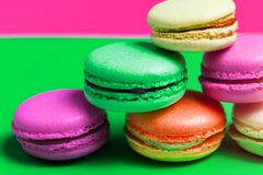 Closeup of colorful pink, orange, green. beige French sweet macaroons on the table stock photos