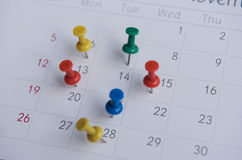 Closeup Colorful Pins Push Marking On A Calendar. Busy Schedule Stock Images