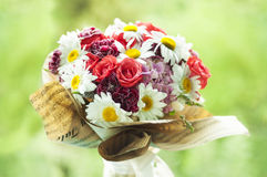 Closeup of colorful roses and daisies bouquet at the window Royalty Free Stock Image