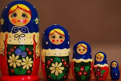 Closeup of colorful russian matryoshkas against blured brown background stock images