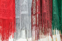 Closeup of 4 colorful scarfs with fringe Royalty Free Stock Images
