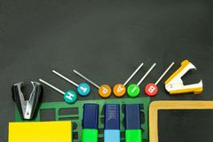Closeup of colorful school supplies with copy space on blackboard background. Back to school. stock image