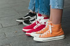Colorful sneakers in the street. Closeup of colorful sneakers in the street vector illustration