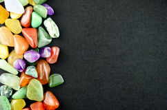 Closeup colorful stones on black background Royalty Free Stock Image