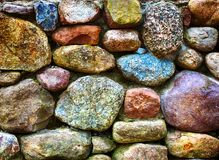 Closeup of colorful stonewall out of big stones. Closeup of colorful stonewall with big stones Stock Photo