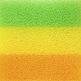 Closeup colour sponges for dishwashing, abstract background.  royalty free stock images