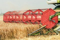 Closeup Combine harvesting a wheat field. Combine working. The field Royalty Free Stock Photos