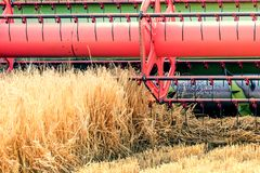 Closeup Combine harvesting a wheat field. Combine working. The field Stock Photos