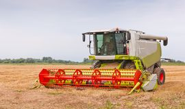 A closeup of a combine after work Royalty Free Stock Photo