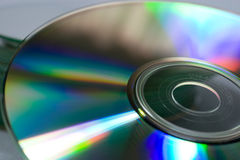 Closeup of a compact disc. A closeup of the back surface of a compact disk, refracting the light shining on it and separating the light into its component Stock Photos