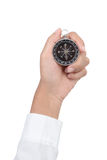 Closeup compass in hand isolated on white background Royalty Free Stock Photos