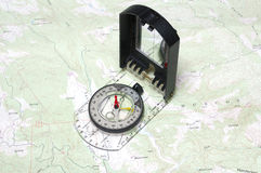 Closeup of compass and map Royalty Free Stock Photo