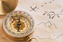 Closeup of compass over stained yellowed paper Royalty Free Stock Photo