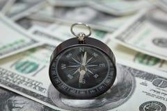 Closeup of a compass on U.S. Dollar banknotes Stock Photos