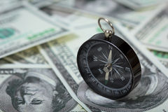 Closeup of a compass on U.S. Dollar banknotes Royalty Free Stock Images