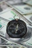 Closeup of a compass on U.S. Dollar banknotes Royalty Free Stock Photos