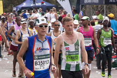 Closeup of Competitors Participating in Comrades Marathon Stock Photos