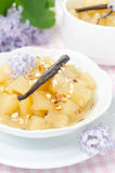 Closeup of compote of apples and pears with vanilla and lilac Stock Images