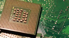 Closeup of Computer Chip Processor over electronic green circuit rotating on dolly. 4K UHD Video. Nikon D500 stock video