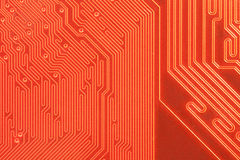 Closeup of computer circuit board in orange Stock Photography