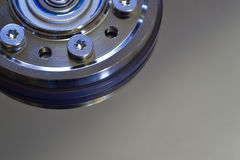 Closeup of Computer Hard Disk With Spindle Hub. Closeup of computer hard disk showing spindle hub with fasteners Royalty Free Stock Images