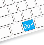 Closeup of a computer keyboard with empty keys and word Do it, w Stock Photos