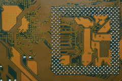 Closeup of computer main board. Back view with electric circuits Royalty Free Stock Photography