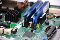 Closeup computer motherboard circuits memory microprocessor. Pci cards royalty free stock photo