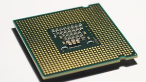 Closeup of computer processor cpu surface. Closeup of computer processor cpu surface rotating on dolly 4K Ultra HD video stock video