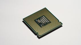 Closeup of computer processor cpu surface. Closeup of computer processor cpu surface rotating on dolly 4K Ultra HD video stock footage
