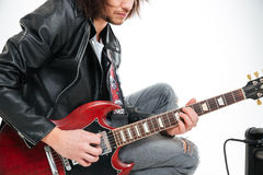 Closeup of concentrated young man playing electric guitar Royalty Free Stock Images