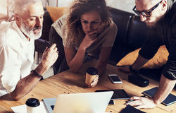 Closeup concept of business people brainstorming.Bearded man talking with account director and creative manager to Stock Photography