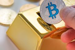 Concept of Cryptocurrency physical bitcoin with gold bullion piggy bank. Closeup on Concept of Cryptocurrency physical bitcoin with gold bullion piggy bank Royalty Free Stock Photo