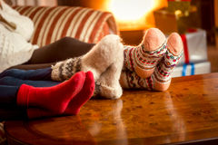 Closeup conceptual shot of family warming feet at fireplace Royalty Free Stock Images