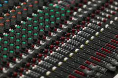 Closeup of a concert sound control board. Royalty Free Stock Photo