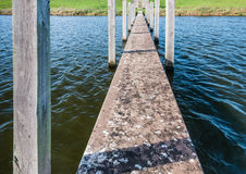 Closeup of a concrete jetty Stock Images