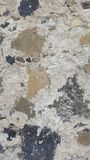 Concrete and stone texture. Closeup of concrete and stone wall background. Texture. Black and brown Stones on grey concrete royalty free stock photos