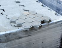 Closeup of concrete tiles floor for the renovation of city sidewalks Royalty Free Stock Images