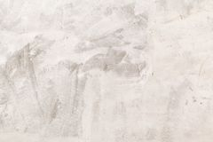 Closeup concrete wall texture with plaster and white paint. Old royalty free stock photos