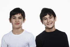 Closeup Of Confident Brothers Smiling Stock Photography