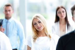 Closeup of confident business woman on blurred background office Royalty Free Stock Photos