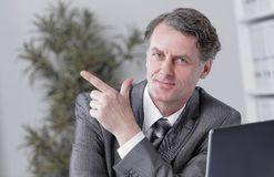 Closeup . confident businessman pointing at copy space. Royalty Free Stock Images