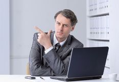 Closeup . confident businessman pointing at copy space. Stock Photos