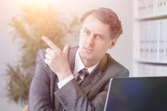 Closeup . confident businessman pointing at copy space. Royalty Free Stock Photos