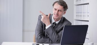 Closeup . confident businessman pointing at copy space. Royalty Free Stock Image