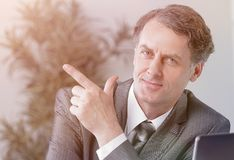 Closeup . confident businessman pointing at copy space. Stock Photo