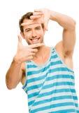 Closeup of confident happy man framing photograph white backgrou Stock Image