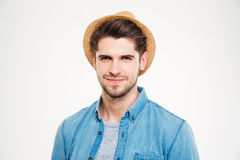 Closeup of confident young man in hat and blue shirt Royalty Free Stock Photo