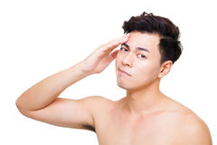 Closeup confuse young man face Stock Photography