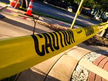 Closeup construction caution tape. Stylistic shot of yellow caution tape outdoors in the summer Stock Photography